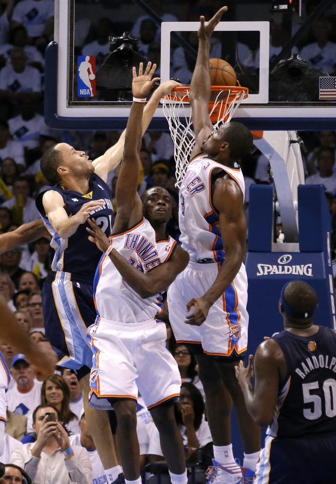Photo - Memphis' Tayshaun Prince dunks the ball over Oklahoma City's Reggie Jackson and SergenIbaka during Game 5 in the second round of the NBA playoffs between the Oklahoma City Thunder and the Memphis Grizzlies at Chesapeake Energy Arena In Oklahoma City, Wednesday, May 15, 2013. Photo by Bryan Terry, The Oklahoman