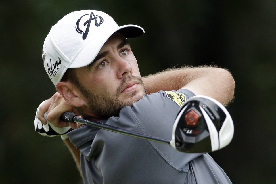 Photo - Troy Merritt tees off on the seventh hole during the third round of the St. Jude Classic golf tournament Saturday, June 7, 2014, in Memphis, Tenn. (AP Photo/Mark Humphrey)