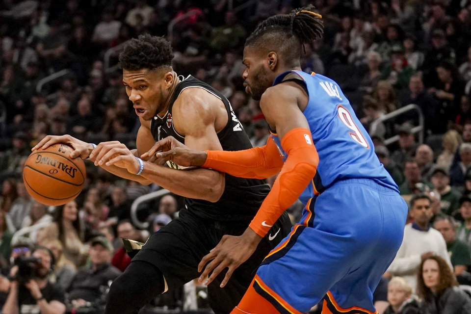 Photo - Milwaukee Bucks' Giannis Antetokounmpo tries to get past Oklahoma City Thunder's Nerlens Noel during the second half of an NBA basketball game Friday, Feb. 28, 2020, in Milwaukee. (AP Photo/Morry Gash)