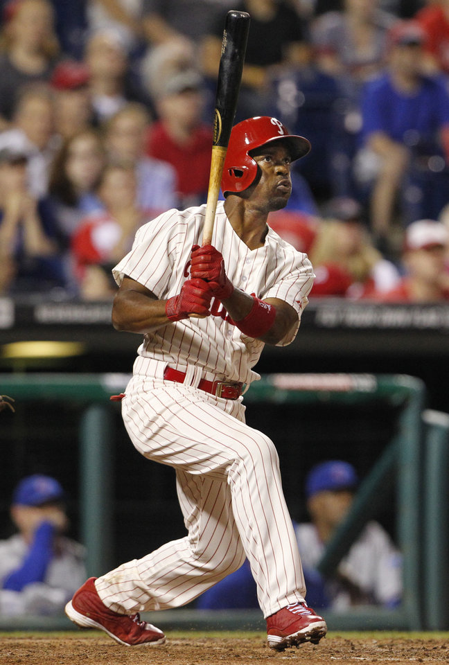 Photo - Philadelphia  Phillies Jimmy Rollins hits a double in the ninth inning of a baseball game against the Chicago Cubs to tie Mike Schmidt for career hits,  Friday, June 13, 2014 at Citizens Bank Park in Philadelphia.   ( AP Photo / The Philadelphia Inquirer, Ron Cortes)