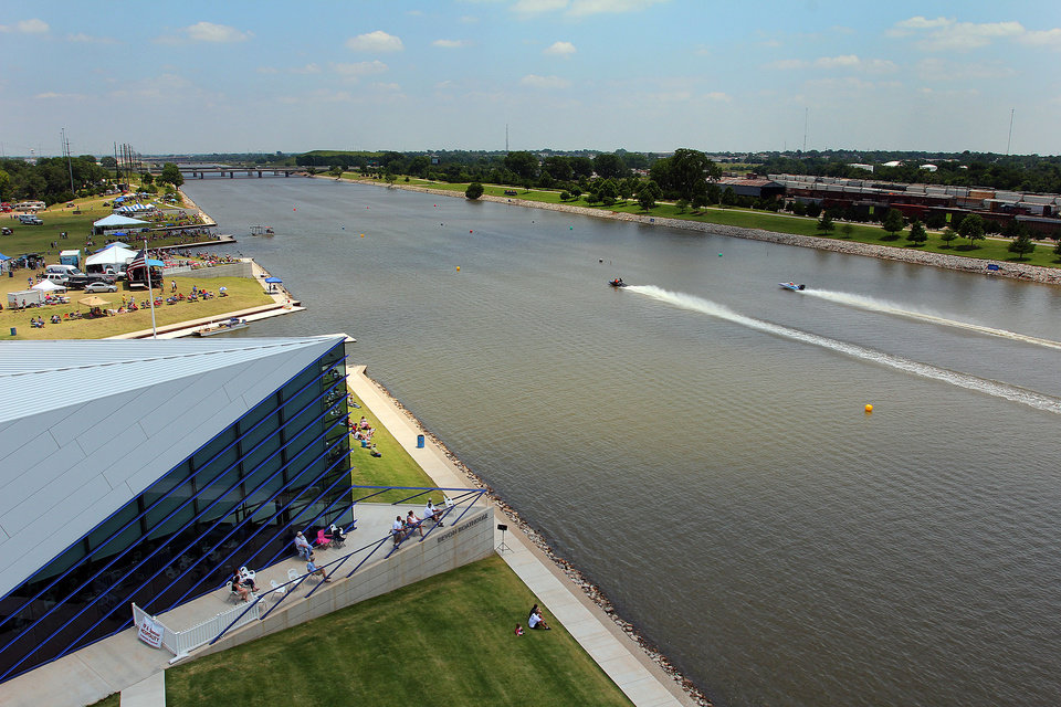 Drag boats race past the Devon Boat House during the Oklahoma City Nationals Drag Boat races on the Oklahoma River Saturday, June 9th, 2012. PHOTO BY HUGH SCOTT, FOR THE OKLAHOMAN   ORG XMIT: KOD