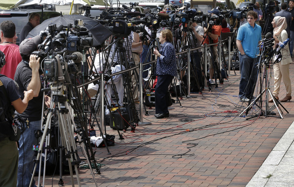Photo - Television cameras sitting on tripods are lined up outside the federal courthouse prior to the scheduled arraignment for Boston Marathon bombing suspect Dzhokhar Tsarnaev Wednesday, July 10, 2013, in Boston. The April 15 attack killed three and wounded more than 260. The 19-year-old Tsarnaev has been charged with using a weapon of mass destruction. (AP Photo/Steven Senne)