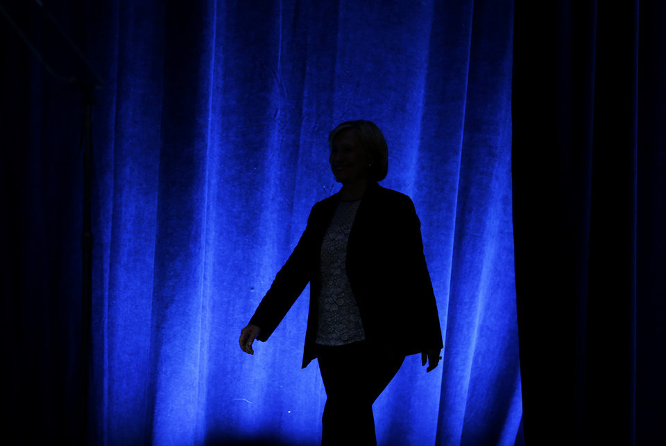 Photo - Former Secretary of State Hillary Rodham Clinton walks on stage before speaking at the National Clean Energy Summit Thursday, Sept. 4, 2014, in Las Vegas. (AP Photo/John Locher)