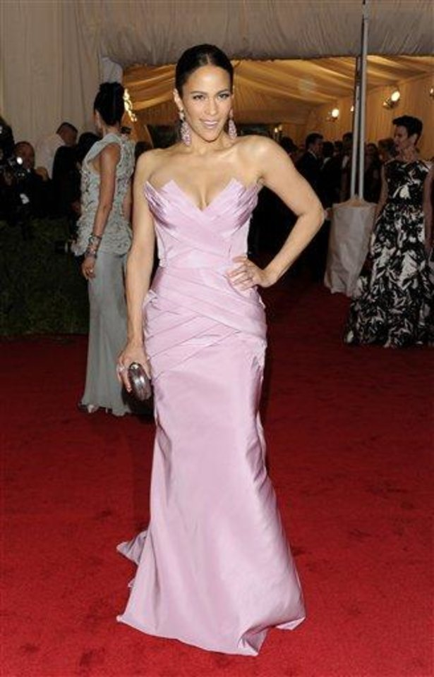 Photo - Paula Patton arrives at the Metropolitan Museum of Art Costume Institute gala benefit, celebrating Elsa Schiaparelli and Miuccia Prada, Monday, May 7, 2012 in New York. (AP Photo/Evan Agostini)