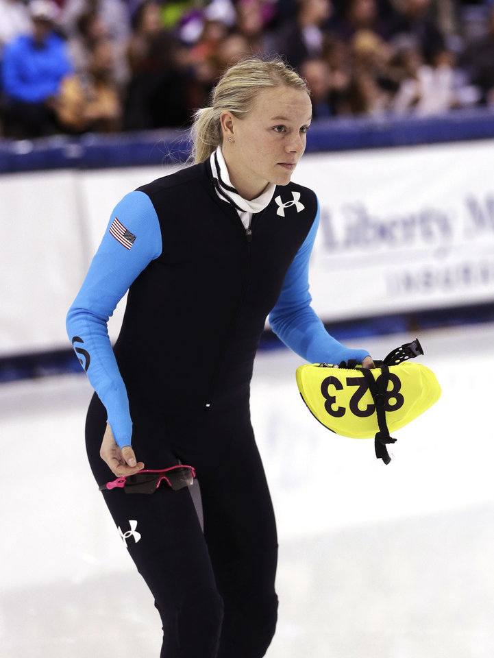 Photo - Emily Scott looks on before competing a race in the women's 1,500 meters during the U.S. Olympic short track speedskating trials, Friday, Jan. 3, 2014, in Kearns, Utah. (AP Photo/Rick Bowmer)