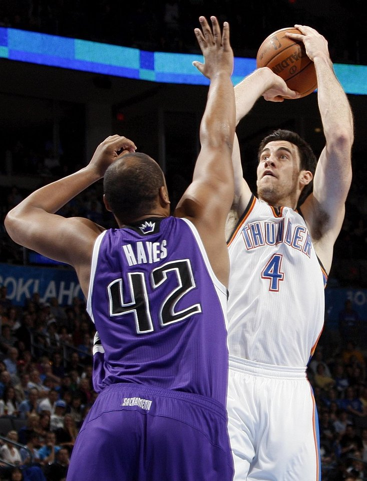 Oklahoma City's Nick Collison (4) shoots over Sacramento's Chuck Hayes (42) during the NBA basketball game between the Oklahoma City Thunder and the Sacramento Kings at Chesapeake Energy Arena in Oklahoma City, Friday, April 13, 2012. Photo by Nate Billings, The Oklahoman