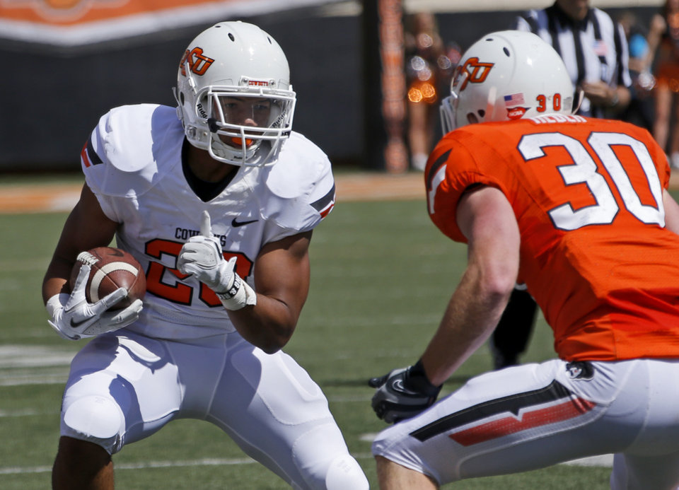 Oklahoma State's Cory Bennett tries to get past Bryant Reber during OSU's spring football game at Boone Pickens Stadium in Stillwater, Okla., Sat., April 20, 2013. Photo by Bryan Terry, The Oklahoman