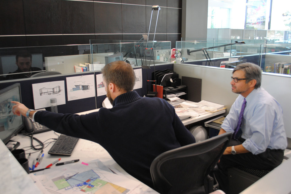 Photo - Cory Baitz and Jorge Charneco, architects with Miles Associates, review plans for the future GE Oil and Gas Technology Center.  Provided