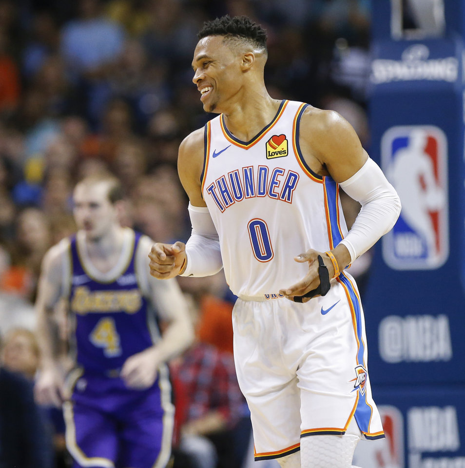 Photo - Oklahoma City's Russell Westbrook (0) smiles after scoring in the fourth quarter during an NBA basketball game between the Los Angeles Lakers and the Oklahoma City Thunder at Chesapeake Energy Arena in Oklahoma City, Tuesday, April 2, 2019. Oklahoma City won 119-103. Photo by Nate Billings, The Oklahoman