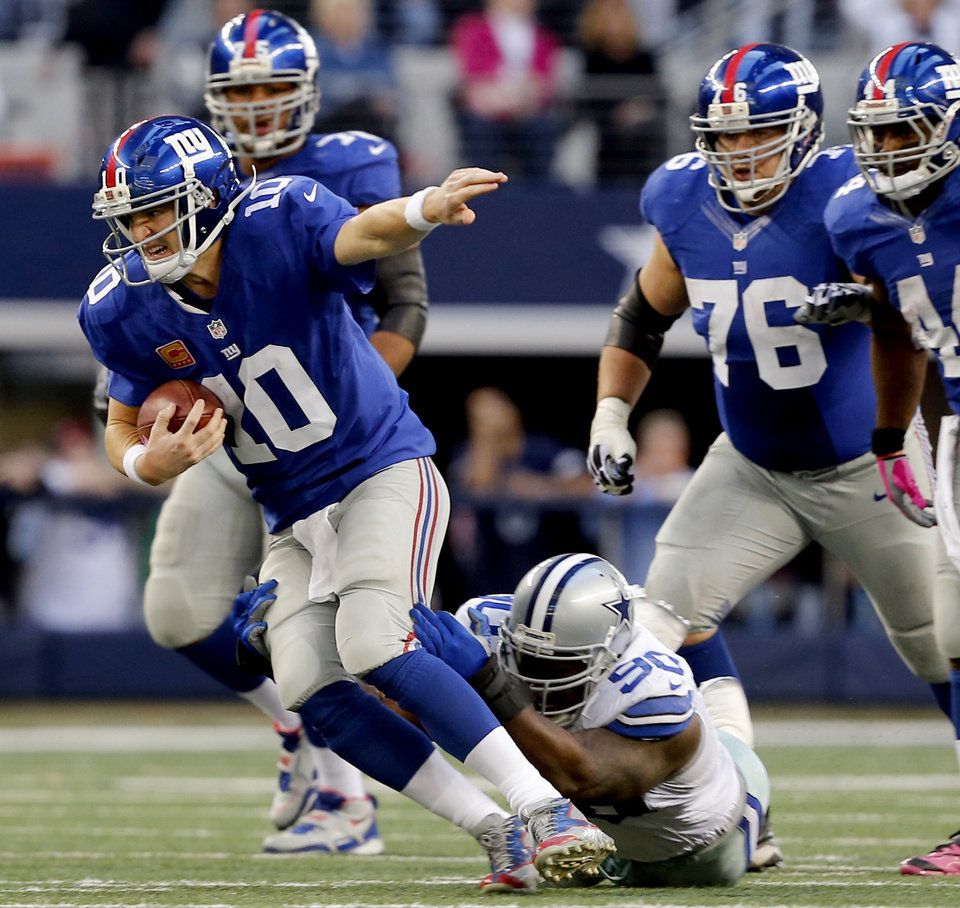 Photo -   New York Giants quarterback Eli Manning (10) is sacked by Dallas Cowboys nose tackle Jay Ratliff (90) during the second half of their NFL football game, Sunday, Oct. 28, 2012, in Arlington, Texas. The Giants won 29-24. (AP Photo/The Waco Tribune-Herald, Jose Yau)
