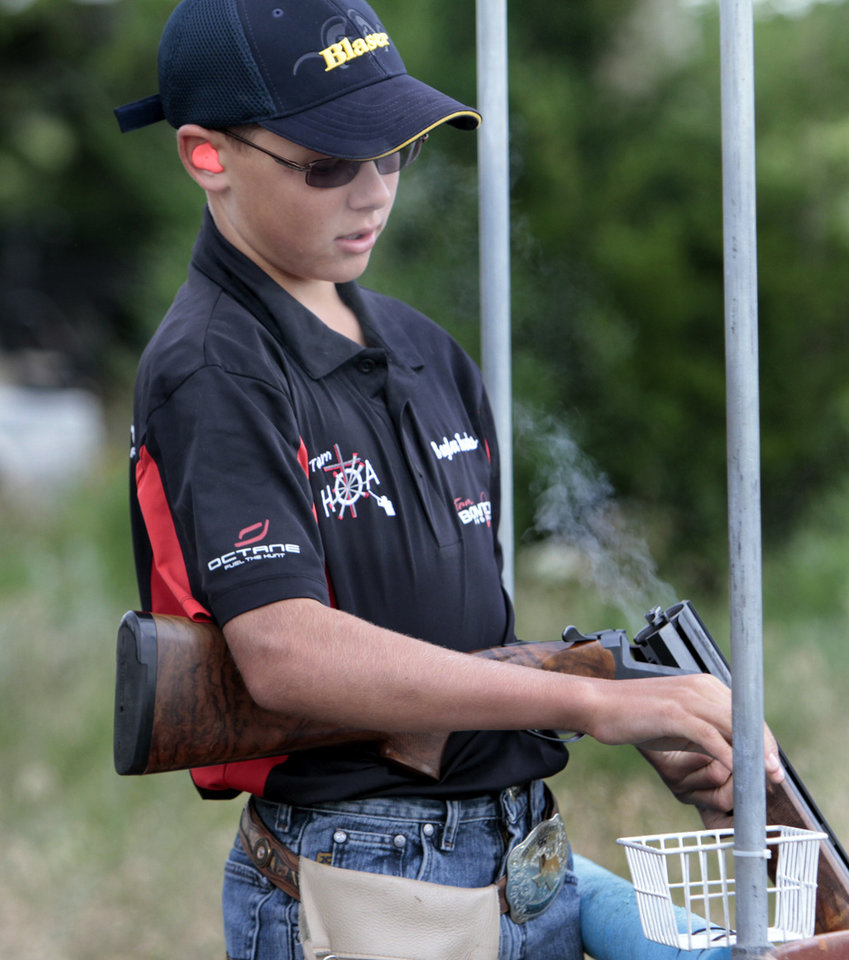 Baylor Brooks, 13 from Stephenville, Texas, reloads his shotgun during the Oklahoma Sporting Clays State Championships being held at Quail Ridge Sporting Clays on Friday, June 1, 2012, in Oklahoma City, Okla.  Photo by Steve Sisney, The Oklahoman