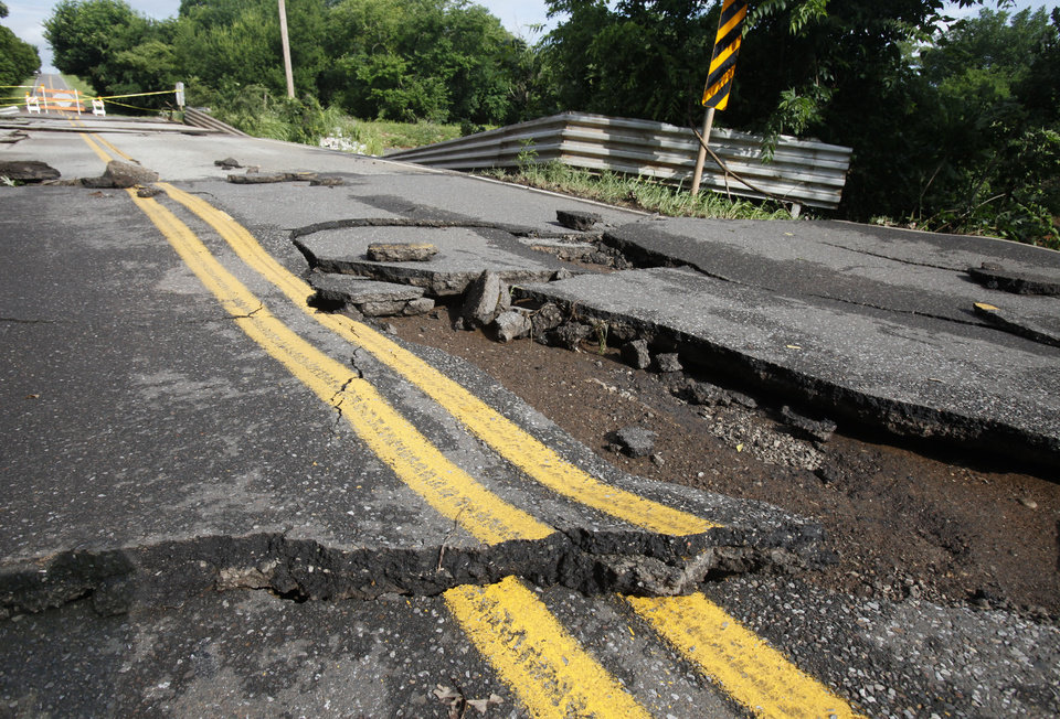 Photo - This bridge on Covell Rd. between Santa Fe and Western in Edmond, OK, was washed out by yesterday's torential rains, Tuesday, June 15, 2010. By Paul Hellstern, The Oklahoman