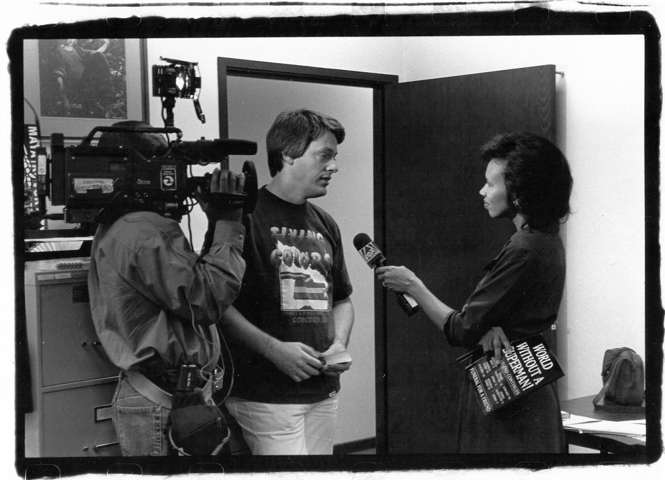 Photo -  In this 1992 photo, retailer Joe Field is being interviewed about the death of Superman by Faith Fancher for the KTVU-Channel 2 News. The photo was taken by Capital City Distribution truck driver Oscar Benjamin, who is now a professional photographer.