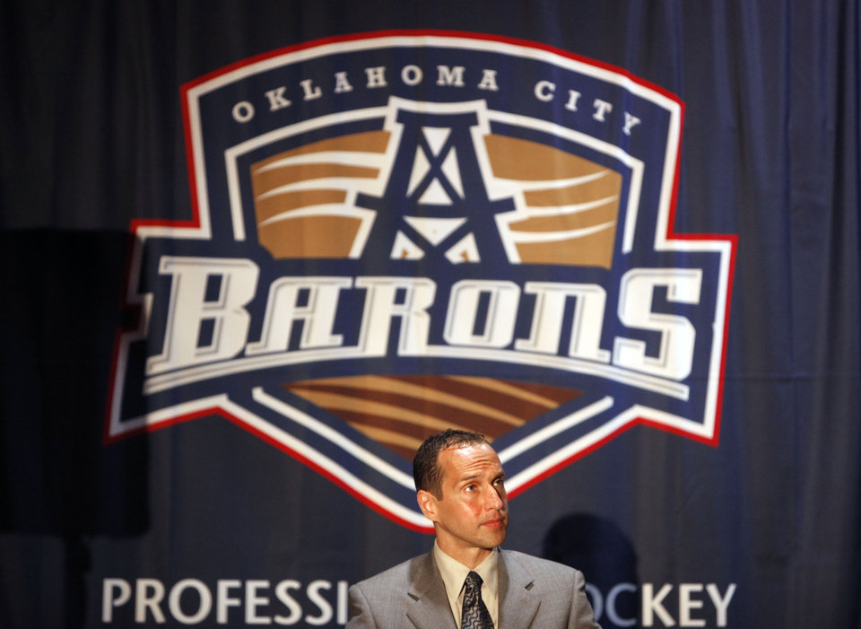 Photo - AMERICAN HOCKEY LEAGUE / AHL: Ricky Olczyk Assistant General Manager & Director of Hockey Operations/Legal Affairs for Edmonton Oilers Hockey Club sits in front of Oklahoma City Barons banner, Wednesday May 19, 2010, at the Cox Convention Center in Oklahoma City . Photo by Sarah Phipps, The Oklahoman  ORG XMIT: KOD