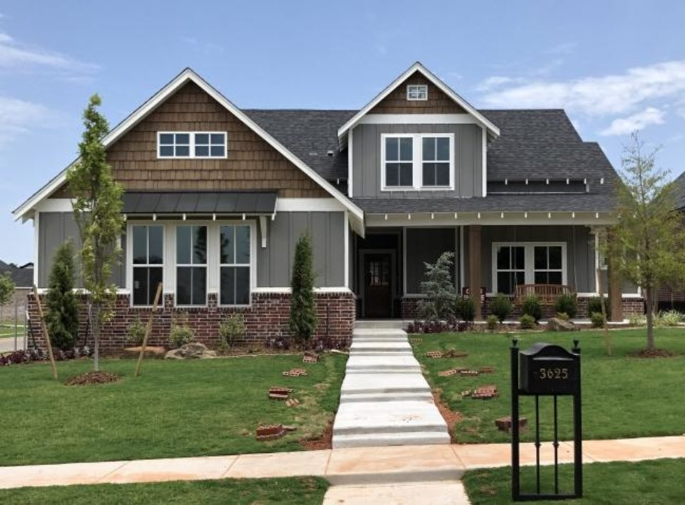 Photo -  McCaleb Homes built this new home for sale at 3625 Rodkey Mill Circle in Edmond's Town Square addition, developed by Caleb McCaleb. [RICHARD MIZE/THE OKLAHOMAN]