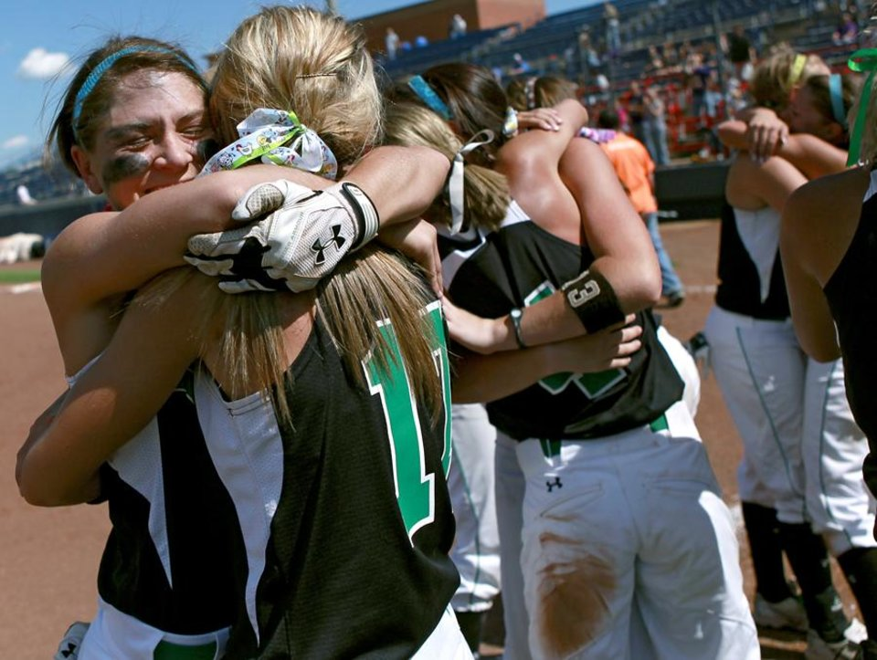 Photo -  CLASS A HIGH SCHOOL SOFTBALL / STATE TOURNAMENT / CELEBRATE / CELEBRATION: Leedey pitcher Sarah Penry (left) gets a hug from teammate Sydney Harrel as the team wins the Class A State Slowpitch Softball Championship at ASA Hall of Fame Stadium in Oklahoma City on Tuesday, May 3, 2011. Leedey beat Red Oak 16-4 in four innings to win the championship. Photo by John Clanton, The Oklahoman ORG XMIT: KOD