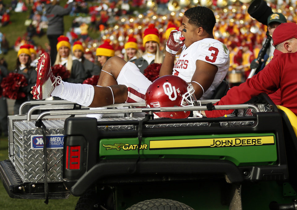 Photo - Oklahoma's Sterling Shepard (3) is carted off the field after being injured in the first quarter during a college football game between the University of Oklahoma Sooners (OU) and the Iowa State Cyclones (ISU) at Jack Trice Stadium in Ames, Iowa, Saturday, Nov. 1, 2014. Photo by Nate Billings, The Oklahoman