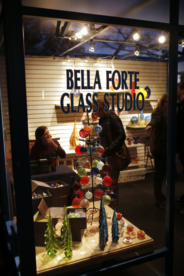 Photo - Bella Forte Glass Studios at the Winter Shops at  Myriad Gardens. Photo by Doug Hoke, The Oklahoman  DOUG HOKE - THE OKLAHOMAN