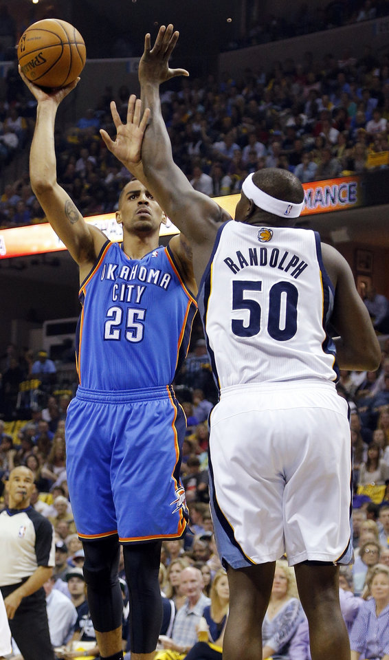 Photo - Oklahoma City's Thabo Sefolosha (25) shoots against Memphis' Zach Randolph (50) during Game 4 in the first round of the NBA playoffs between the Oklahoma City Thunder and the Memphis Grizzlies at FedExForum in Memphis, Tenn., Saturday, April 26, 2014. Photo by Bryan Terry, The Oklahoman