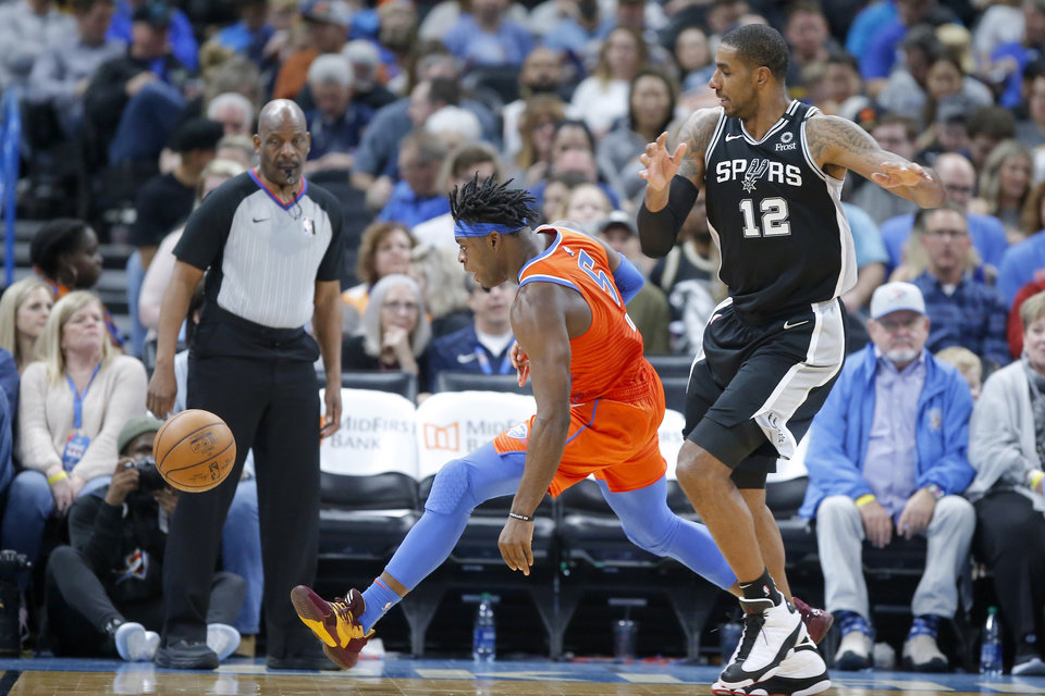 Photo - Oklahoma City's Luguentz Dort (5) knocks the ball away from San Antonio's LaMarcus Aldridge (12) during an NBA basketball game between the Oklahoma City Thunder and the San Antonio Spurs at Chesapeake Energy Arena in Oklahoma City, Sunday, Feb. 23, 2020. Oklahoma city won 131-103. [Bryan Terry/The Oklahoman]