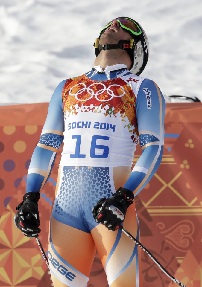 Photo - Norway's Aksel Lund Svindal catches his breath after the men's super-G at the Sochi 2014 Winter Olympics, Sunday, Feb. 16, 2014, in Krasnaya Polyana, Russia. (AP Photo/Gero Breloer)