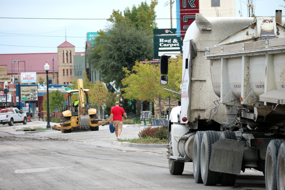 Photo -  Business owners along this stretch of N Western say they are dependent on easy access to cars and pedestrian foot traffic. This stretch of Western is closed for resurfacing. [Photo by Doug Hoke, The Oklahoman]