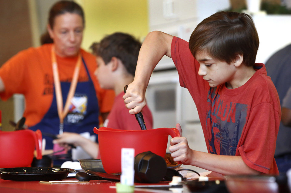 Zachary Jenkins, 11, stirs batter for his pumpkin spice pancakes while competing in the Shawnee Mills'  Kids' Pancakes, Flapjacks and Griddle Cakes Contest at the Oklahoma State Fair on Saturday, Sep. 22, 2012. The event was held in the Creative Arts Building. Jenkins lives in Newalla and is a 6th grade home-schooled student.   Photo by Jim Beckel, The Oklahoman.