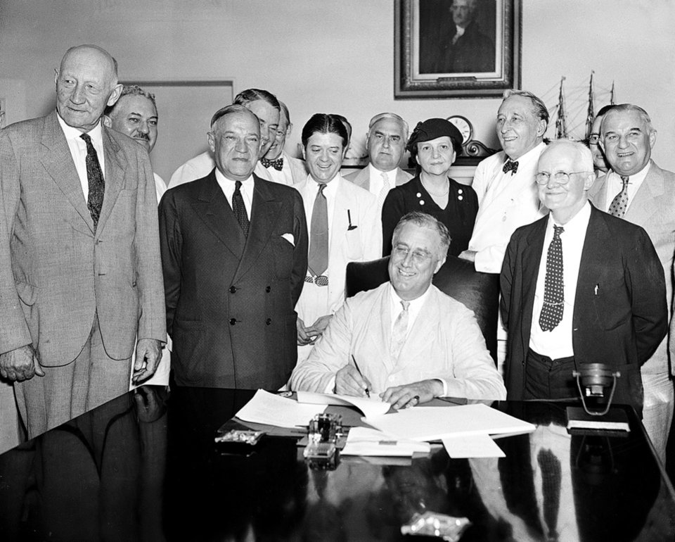 Photo -   FLE - In this Aug. 14, 1935, file photo President Franklin Roosevelt signs the Social Security Bill in Washington. For millions of retired and disabled workers today Social Security is pretty much all they have to live on, even though monthly benefits are barely enough to keep them out of poverty. Monthly payments average $1,237 for retired workers and $1,111 for disabled workers. Most older Americans rely on Social Security for a majority of their income; many rely on it for 90 percent or more, according to the Social Security Administration. (AP Photo, File)