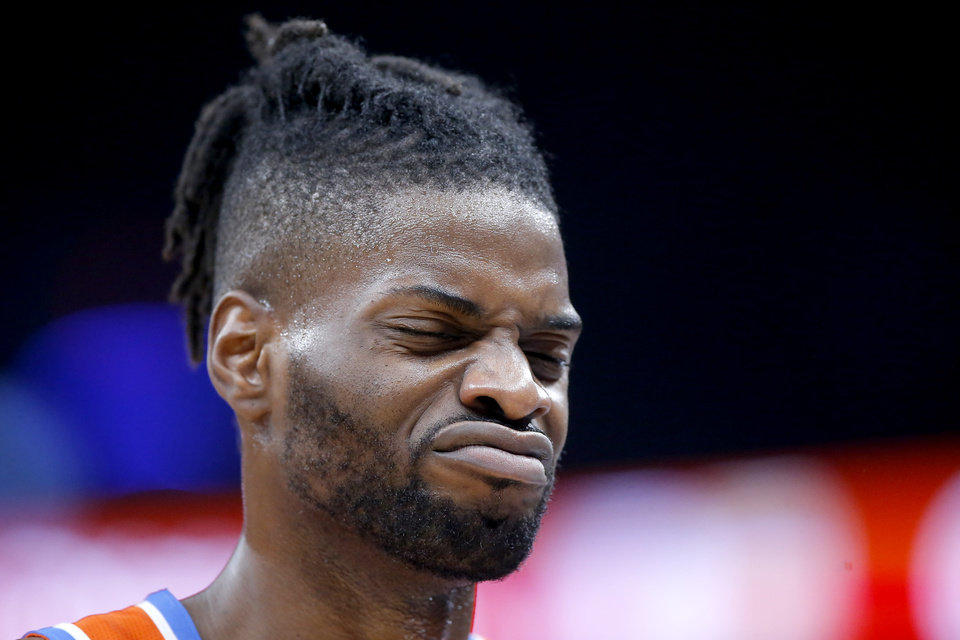 Photo - Oklahoma City's Nerlens Noel (9) walks back to the bench during an NBA basketball game between the Oklahoma City Thunder and the San Antonio Spurs at Chesapeake Energy Arena in Oklahoma City, Sunday, Feb. 23, 2020. Oklahoma city won 131-103. [Bryan Terry/The Oklahoman]