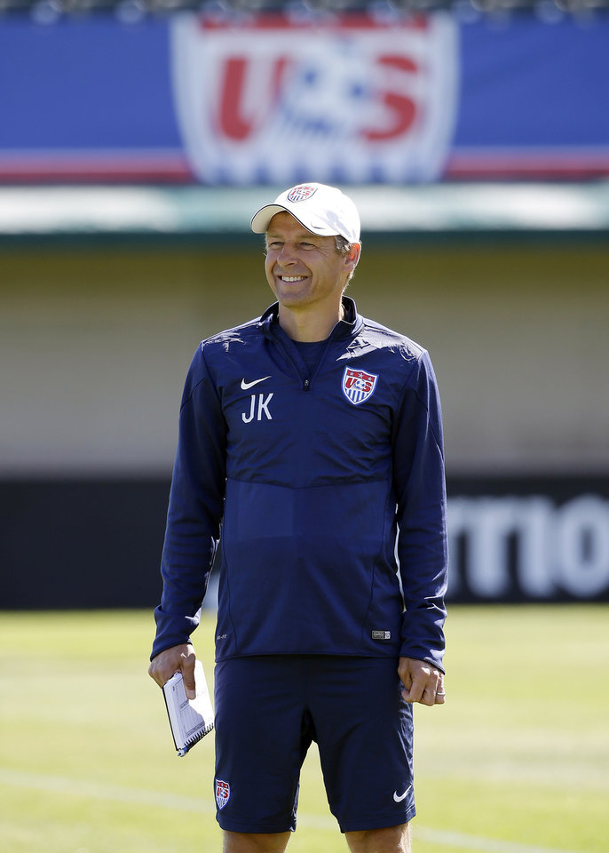 Photo - United States head coach Jurgen Klinsmann smiles as his team trains in preparation for the World Cup soccer tournament on Wednesday, May 21, 2014, in Stanford , Calif. (AP Photo/Marcio Jose Sanchez)
