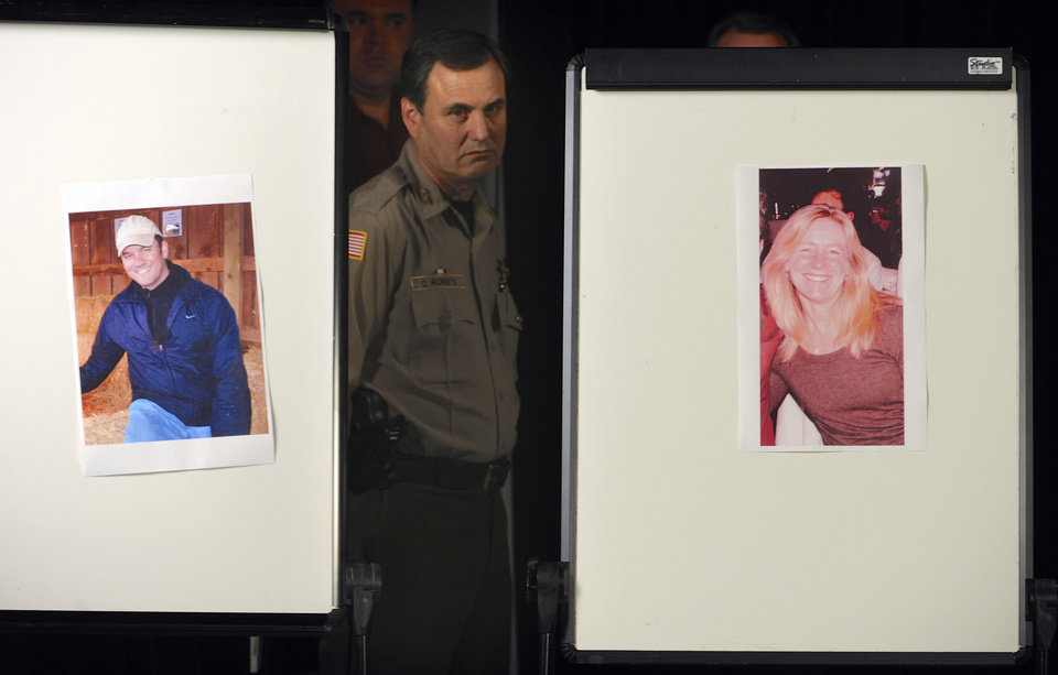 Photo - Clackamas County Sherriff Craig Roberts is framed by photos of Clackamas Town Center shooting victims Steven Forsyth, left, and Cindy Yullie, during a news conference Wednesday, Dec. 12, 2012 in Portland, Ore., Wednesday Dec. 12, 2012. The gunman who killed Forsyth, Yullie and himself in a shooting rampage was 22 years old and used a stolen rifle from someone he knew, authorities said Wednesday. (AP Photo/Greg Wahl-Stephens) ORG XMIT: ORGW116