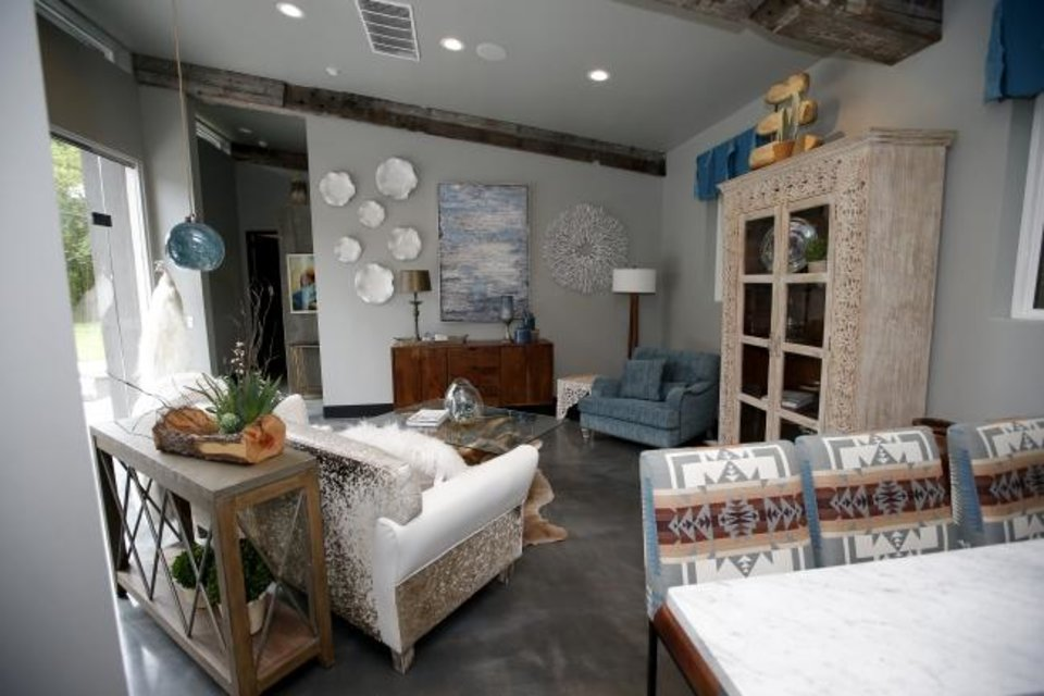 Photo -  Guest quarters and living area was designed by Kari Lopez, Renae Brady and Tracy Knoche, of LOREC Ranch Home Furnishings. [SARAH PHIPPS/THE OKLAHOMAN]