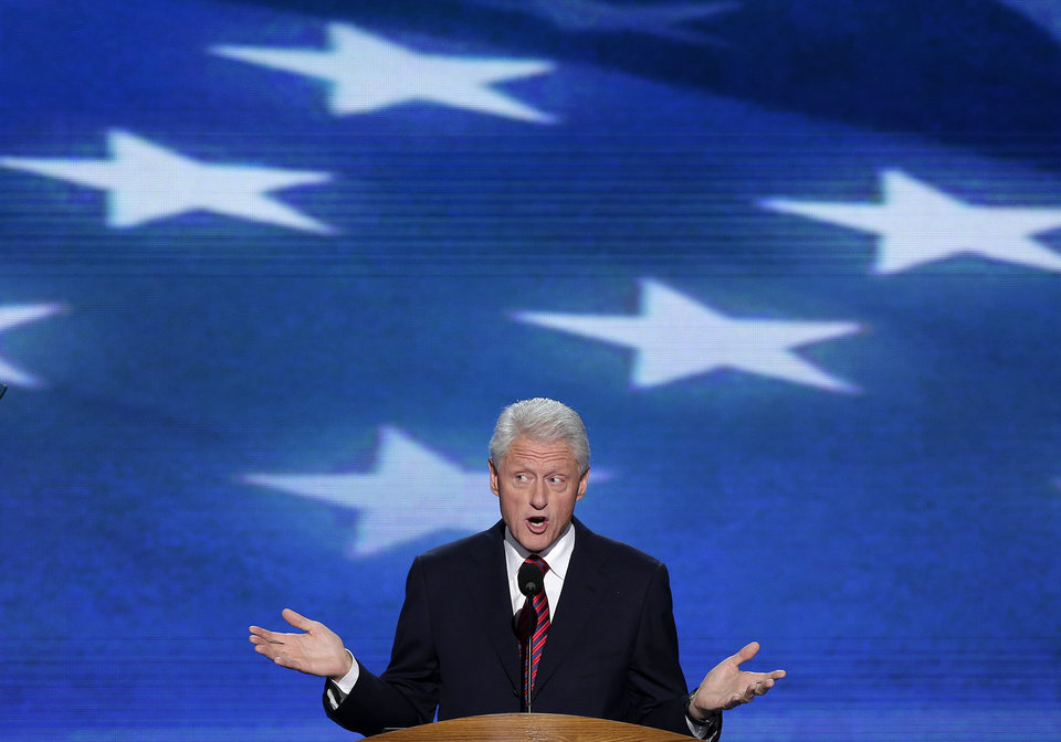 Photo - Former President Bill Clinton addresses the Democratic National Convention in Charlotte, N.C., on Wednesday, Sept. 5, 2012. (AP Photo/J. Scott Applewhite)  ORG XMIT: DNC180