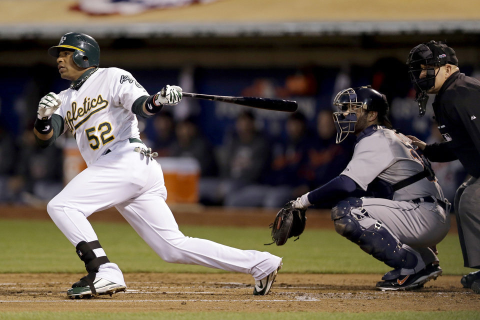 Oakland Athletics' Yoenis Cespedes hits a single in the first inning of Game 4 of their American League division baseball series against the Detroit Tigers in Oakland, Calif., Wednesday, Oct. 10, 2012. (AP Photo/Marcio Jose Sanchez)
