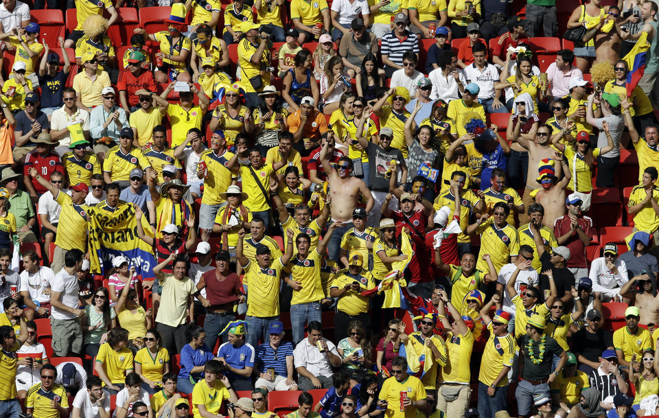 Photo - Colombia's fans celebrate one of their team's goals during the group C World Cup soccer match between Colombia and Ivory Coast at the Estadio Nacional in Brasilia, Brazil, Thursday, June 19, 2014. Colombia won 2-1. (AP Photo/Themba Hadebe)
