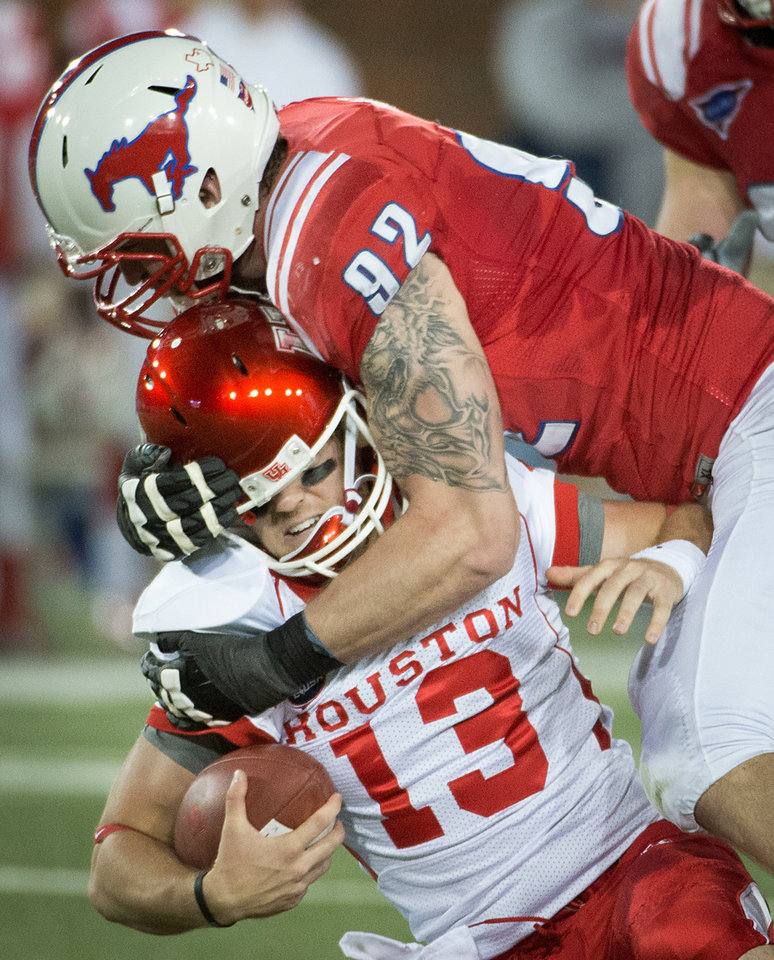 Photo -   Houston backup quarterback Crawford Jones (13) is sacked by Southern Methodist defensive end Margus Hunt (92) during the second quarter of an NCAA college football game Thursday, Oct. 18, 2012, in Dallas. (AP Photo/Houston Chronicle, Smiley N. Pool) MANDATORY CREDIT