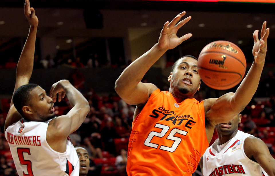 Oklahoma State's Darrell Williams (25) grabs a rebound over Texas Tech's D'walyn Roberts (5) during their NCAA college basketball game at United Spirit Arena in Lubbock, Texas, Saturday, Jan. 29, 2011. (AP Photo/Lubbock Avalanche-Journal, Miranda Grubbs)