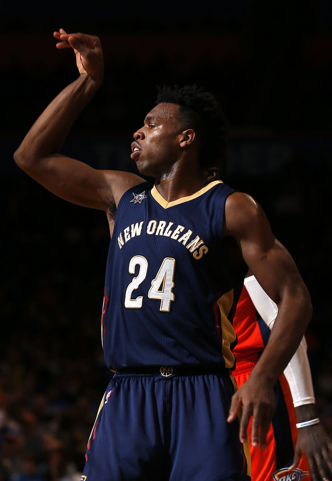 Photo - New Orleans' Buddy Hield (24) reacts after a 3-point shot during the NBA game between the Oklahoma City Thunder and the New Orleans Pelicans at the Chesapeake Energy Arena,  Sunday, Dec. 4, 2016. Photo by Sarah Phipps, The Oklahoman