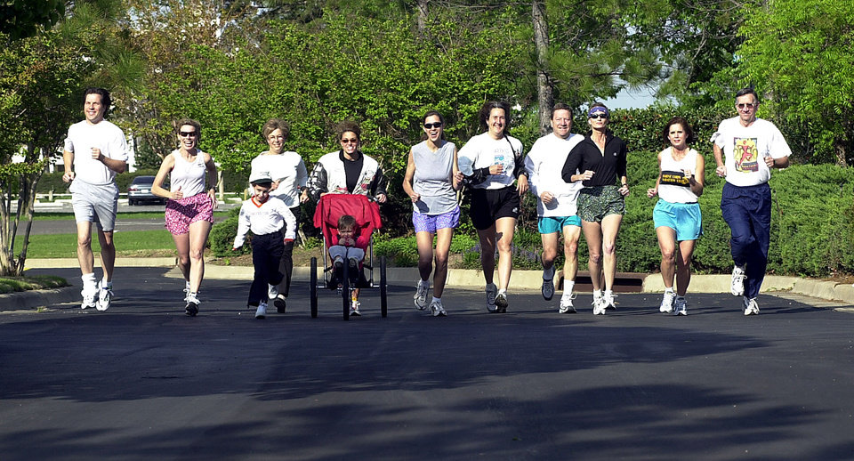 Photo - RUNNING: L to R. James Kruger, Barb Hopper, Claire Miller, Mary Rice, Aidan Miller, Deana Miller, Maria Kolar, Debbie Smith, Ted Barlows, Penny Voss, Cindy English and Tollie Bibb. These local runners are preparing for the Oklahoma City Memorial Marathon. Staff Photo by Ty Russell.