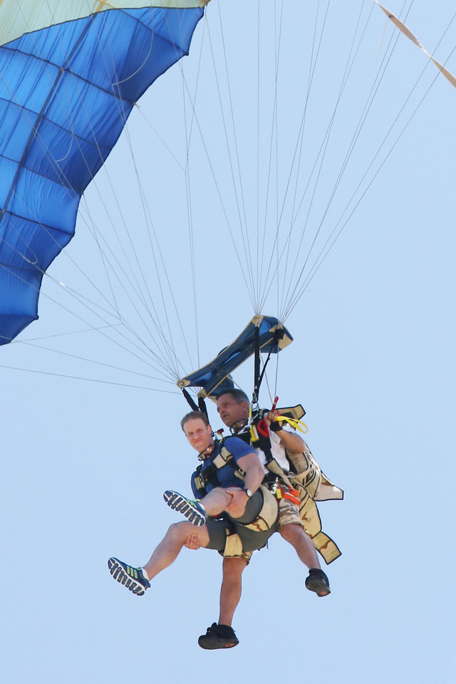 Photo - Anthony (left) must sky dive 10,000 feet from a helicopter while his brother Bates takes a water taxi to meet him at the landing zone in order to receive the next clue on THE AMAZING RACE, premiering Sunday on CBS. Photo: Robert Voets/CBS  Robert Voets