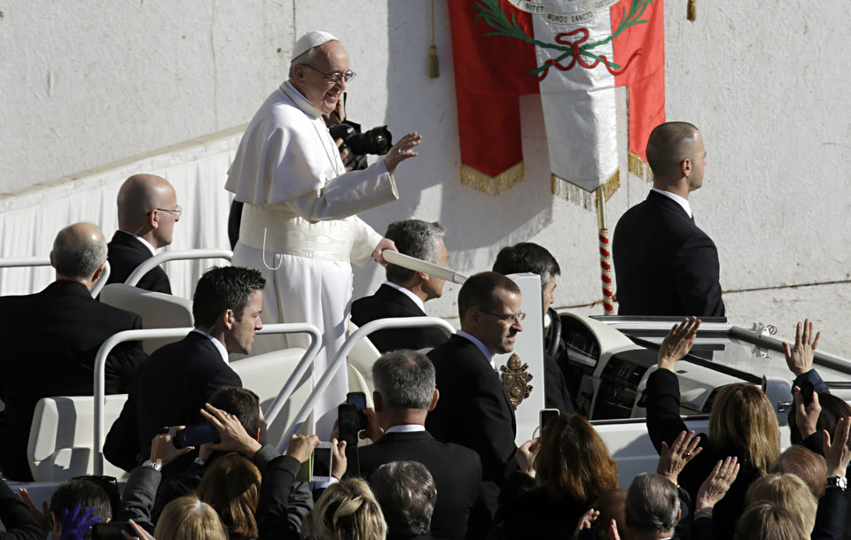 Pope Francis waves upon his arrival in St. Peter's Square for his inaugural Mass, at the Vatican, Tuesday, March 19, 2013. (AP Photo/Andrew Medichini)