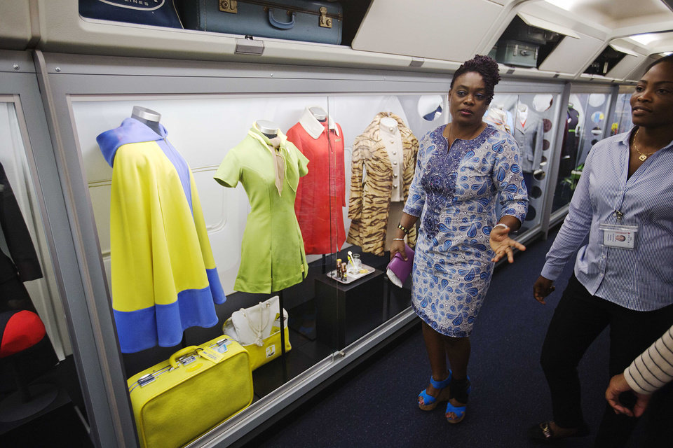 Photo - Vintage flight attendant uniforms are showcased in an exhibit at the grand opening of the new Delta Flight Museum, Tuesday, June 17, 2014, in Atlanta. Delta Air Lines is re-opening a museum at its Atlanta headquarters after extensive renovations in hopes of luring tourists to the company's original aircraft maintenance hangars on the north edge of the world's busiest airport. The 68,000-square-foot museum, housed in hangers that date to the 1940s, traces Delta's history from crop-dusting and air mail service to its first passenger flight from Dallas to Jackson, Mississippi, on June 17, 1929. (AP Photo/David Goldman)