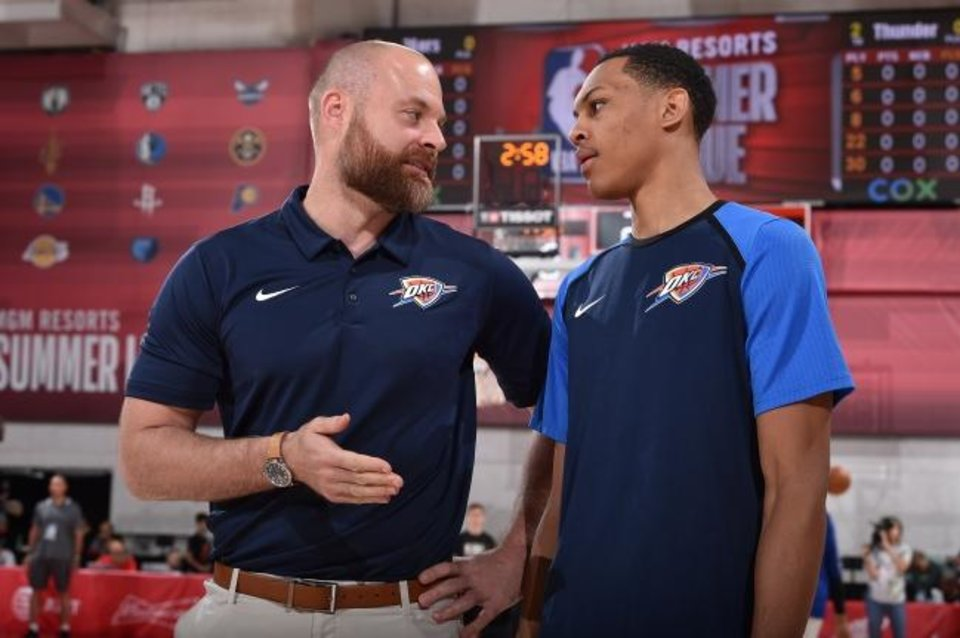 Photo -  Thunder assistant coach Dave Bliss talks with first-round pick Darius Bazley at summer league on July 8. [David Dow/NBAE via Getty Images]