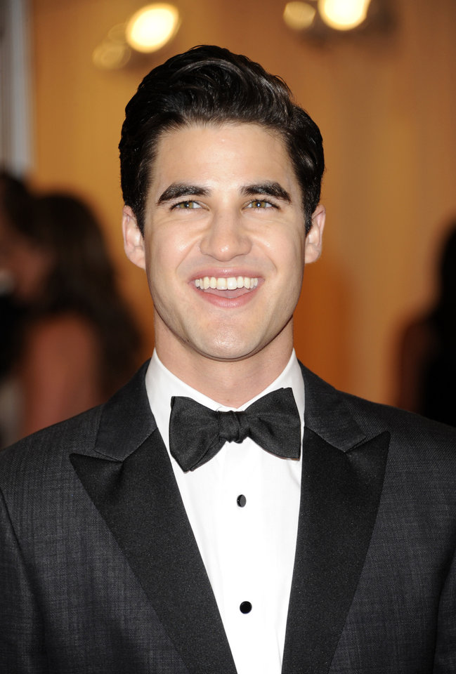 Darren Criss arrives at the Metropolitan Museum of Art Costume Institute gala benefit, celebrating Elsa Schiaparelli and Miuccia Prada, Monday, May 7, 2012 in New York. (AP Photo/Evan Agostini)