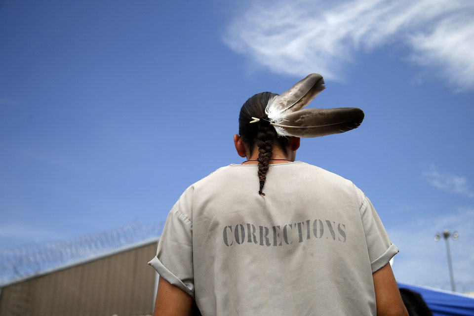 Photo - An inmate dances during the 27th Annual Confined Inter-Tribal Group Gourd Dance & Pow-Wow inside Joseph Harp Correctional Center in Lexington, Okla., on Friday, September 9, 2016. Photo by Bryan Terry, The Oklahoman
