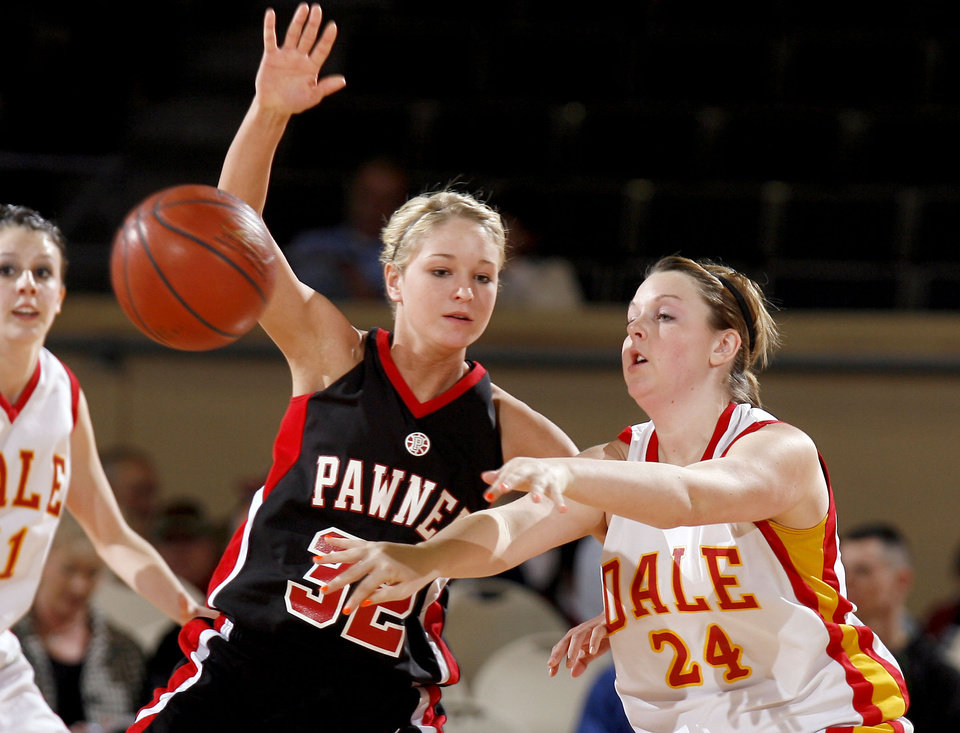 Photo - Dale's Ashley Long (24) passes the ball as Pawnee's Kaytlyn Rice (32) defends her during the girls 2A semifinal between Dale and Pawnee at the State Fair Arena, Friday, March 13, 2009, in Oklahoma City. PHOTO BY SARAH PHIPPS, THE OKLAHOMAN