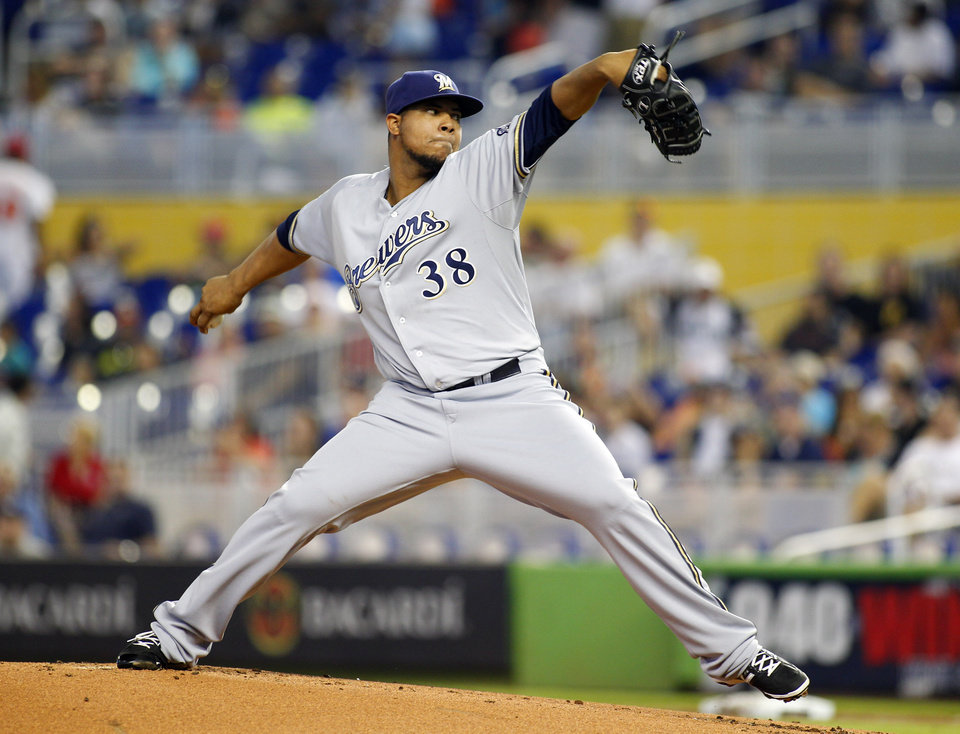 Photo - Milwaukee Brewers pitcher Wily Peralta throws against the Miami Marlins in the first inning of a baseball game in Miami, Saturday, May 24, 2014. (AP Photo/Joe Skipper)