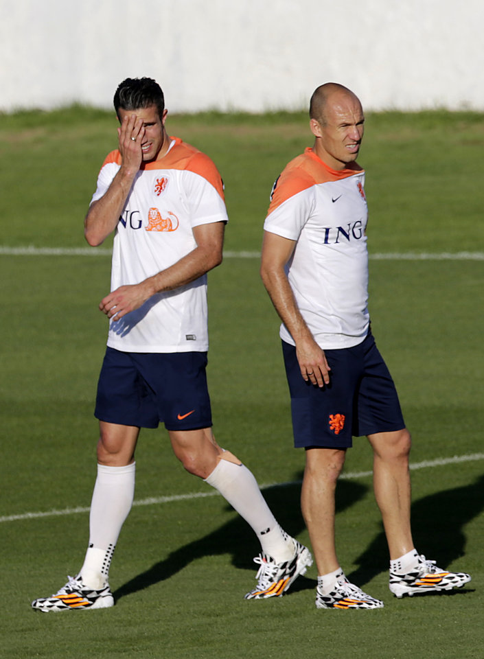 Photo - Robin van Persie, left and Arjen Robben of the Netherlands are seen during a training session in Rio de Janeiro, Brazil, Sunday, June 15, 2014.  The Netherlands play in group B of the 2014 soccer World Cup. (AP Photo/Wong Maye-E)