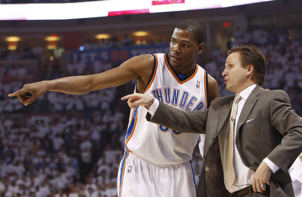 Photo - THE STUDENT :  Remember, Kevin Durant is still only 21. Shown here taking instruction from Scott Brooks during Game 3 of the NBA Playoff series with the Lakers, Durant is quick to remind everyone he and his teammates are still learning.  %u201CAs an individual, I%u2019m just working on everything,
