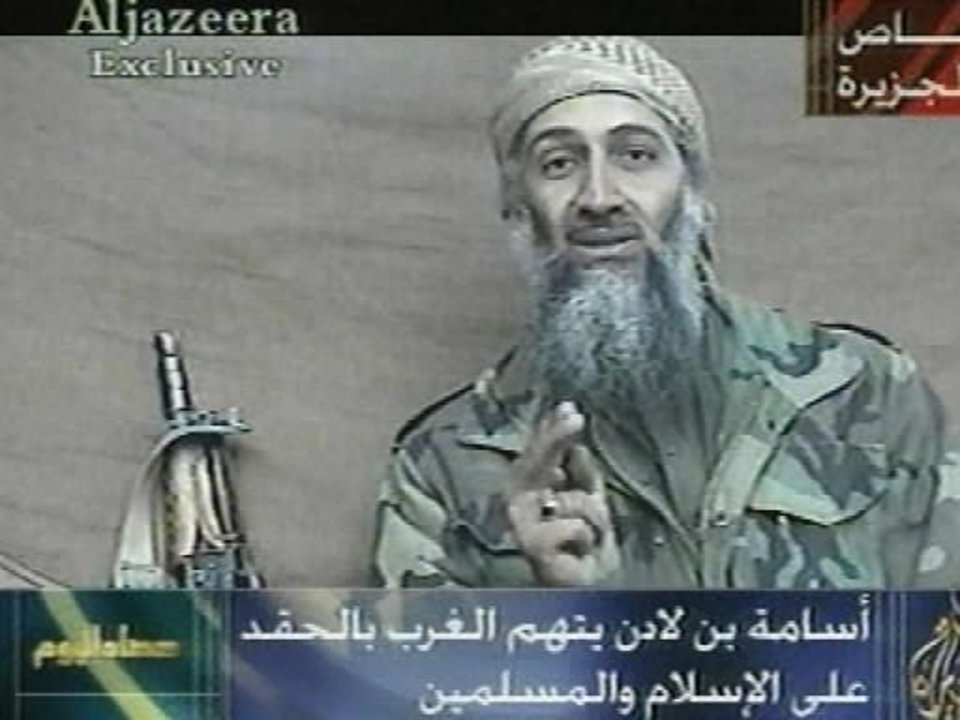 Photo - In this image made from video, first broadcast by the Qatar-based television station Al-Jazeera on Wednesday, Dec. 26, 2001, Osama Bin Laden speaks from an undisclosed location at an undisclosed time. His statements indicated he was speaking in recent weeks. Writing at bottom center reads